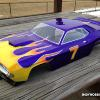 This is an HPI 1970 Dodge Challenger.  All graphics were hand cut.  Flames and numerals.  Its purple metallic Faskolor with chrome and Fasorange and Fasyellow.  I love the Challenger for VTA.  Great looking body even without paint.