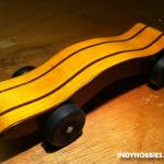 This car was created by carefully slicing the original block of pine and then laminating some mahogany along with the pine.  Then, the shape was cut out.  This was created for the Brownsburg Motorsports Celebration Pinewood Derby.  You can find more information on this great eve